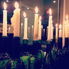 I clustered these candles in rinsed wine bottles for an event. Use for centerpiece, a mantle or cluster in an empty fireplace.