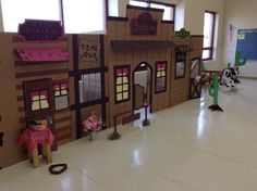 I made this western town for my daughters 1st birthday. Everything is made of cardboard with some scrap wood behind to brace it up. Took a w...