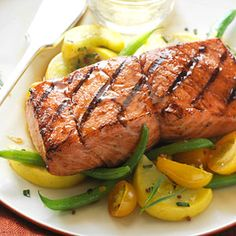 Salmon Hobo Packs - Grilled salmon stays moist when wrapped in foil. Sounds like easy clean up! Vegetables are added to make an easy fast dinner. Healthy Grilling, Grilling Recipes, Fish Recipes, Seafood Recipes, Gourmet Recipes, Cooking Recipes, Healthy Recipes, Gourmet Foods, Yummy Recipes