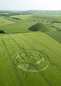 A crop circle is seen near Silbury Hill in Wiltshire, England, on July 8 Some believes it holds a message from ancient Egyptian mythology.