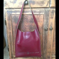 Red Leather Handbag This red leather handbag with laser cut design detail is in excellent condition.  Like New! Mandoni New York Bags