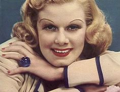 Jean Harlow wearing a huge 152-carat star sapphire ring from William Powell. A cover image for Movie Mirror magazine: