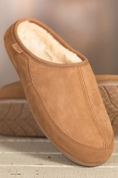 Superbly crafted in genuine sheepskin, these slippers surround your grateful feet in the cushion sheepskin and coddle you in softness and warmth.