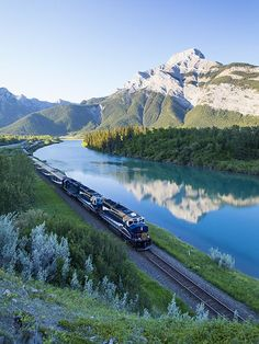 Picture of the Rocky Mountaineer passenger train as seen at dawn near Exshaw, Alberta, Canada