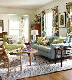 Family room.  White panel walls.  Dark wood furniture.  Colors.  Pattern curtains... Love this look!