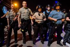 A lawsuit brought by four journalists alleges St Louis County police unlawfully detained them last summer during protests over the Michael Brown shooting.
