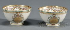 Two Chinese Export Porcelain Enamel and Gilt Decorated Tea Bowls, late 18th century, shaped rims, bowl sides decorated with a pendant oval filled with gilt squiggle-line and polychrome enamel flower designs suspended from a green and gilt ribbon, interior rim border with polychrome floral garland and gilt fringe swags, ht. 1 7/8, dia. 3 1/8 in.  Estimate 250-350