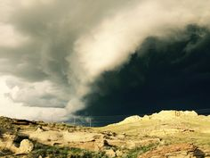 Storm cell rolling over the sand rocks north of Kaycee, WY toward our back door