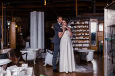 Intimate natural light portrait of bride and groom at Salvage One by Chicago wedding photographer Emma Mullins Photography.