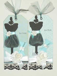 baby blue and black dress form tag