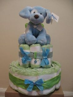 diaper cake for baby shower with stuffed animal as topper