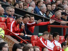 Louis van Gaal (centre) tries to plot a way back into the match after Ki put Swansea ahead