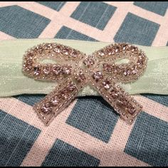Jolie Boutique Headband  Brand new, never worn. Mint green elastic headband w Swarovski crystal bow. Has a tiny snag in fourth pic. Not noticeable when worn. :) Jolie Accessories Hair Accessories