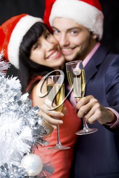 iPHOTOS.com - Stock Photo of a Happy Couple with Champagne Flutes #christmas #photos #photography