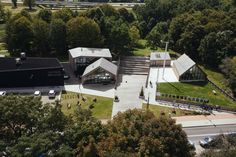 Image 6 of 14 from gallery of Sluzewski Culture Centre / WWAA + Photograph by Rafał Kłos Wooden Facade, Pavilion Architecture, Community Space, Gable Roof, Private Club, Cultural Center, Warsaw, Parking, Centre