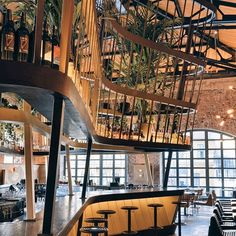 """""""inside #istanbul's historic #bomaontibrewery, autoban has designed the 'kilimanjaro restaurant and bar' complementing its warehouse setting.  see more…"""""""
