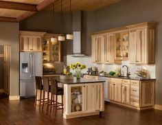 10 Amazing Modern Hickory Kitchen Cabinets for Your Home Design : Light Wood Hickory Kitchen Cabinets With White Backsplash And Vent Hood Also Black Countertops Plus Open Shelving And Brown Bar Stools Also Drum Pendant Light Plus Hardwood Floor And Grey Walls: