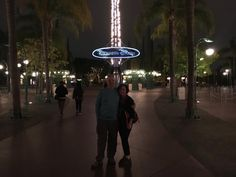 One photo per day: about 11 hours after leaving our house we are standing in Downtown Disney at Disneyland.