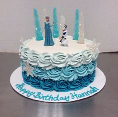 Frozen birthday cake with ombre rosettes.