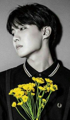 The dilemma of flowers reaching for the sun but also being in danger of being cut by his jawline.