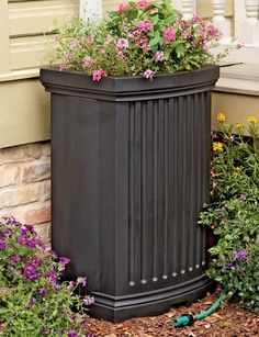 If I had a rain barrel, I'd want it to be something like this one: pretty, not to big, with plants growing on top. Maybe even incorporated into my deck.