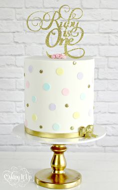 Sweet little one tier first birthday cake with pastel polka dots and glitter topper. www.facebook.com/cakingitup