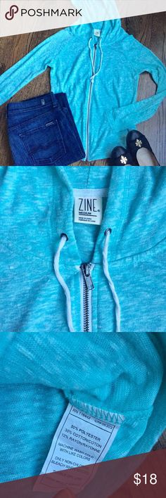 Zine Blue Hoodie Zine Blue Hoodie. Light weight and super soft, heathered tone on tone woven fabric though not see through. Light ocean blue color. Great for the summer over a swim suit. Only worn twice before my pregnancies. Zine Clothing Tops Sweatshirts & Hoodies