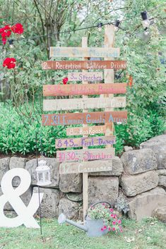 Rustic Wooden Order of The day Sign post - At Home Rustic Tipi Wedding in Hastings | Navy Wedding Party Suits & Gowns | Festoon Lights | White Stag Wedding Photography | David Findlay Video Filming