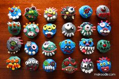 Monster Cupcakes. Seriously, my daughters would LOVE to have a hand in making these! The blog shows full details of each and every monster, too!
