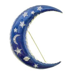 A great vintage crescent moon brooch in dark blue enamel. It is covered with stars and other celestial shapes, with imbedded crystal rhinestones in each. Around the edge of the moon is a thin band of