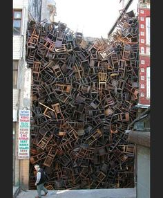 Doris Salcedo, '1600 Stacked Chairs' Urban Installation - 'displacing a space people normally think of as empty'