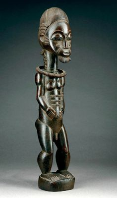 Africa | Statue from the Baule people of the Ivory Coast | Wood, with a dark brown shiny patina