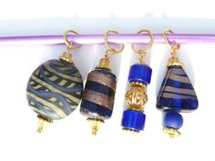 SALE - Blue and gold Lampwork Bead Stitch Markers (up to Size 10 needle). $ 8.00, via Etsy.