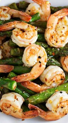 Shrimp and Asparagus Stir Fry with Lemon Sauce. A healthy dinner recipe for any weeknight. Shrimp is a low calorie, high protein seafood that is perfect with vegetables. Pin now to make this healthy recipe later. Think Food, I Love Food, Food For Thought, Asparagus Stir Fry, Shrimp And Asparagus, Recipe For Asparagus, Lemon Pepper Shrimp, Lemon Asparagus, Garlic Shrimp