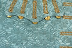 3-piece suit (detail pocket), France, 1725-1750. Pale blue silk damask with a stylised leaf-patterned design.