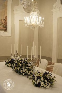 FLORENCE - Wedding reception arrangements, made for a winter wedding at the Four Season Hotel (Florence, Italy) on Jan 27th, 2013.    Wedding planner: Garnet Wedding Studio    Wedding  centerpieces (view the model here) are made of Hedera Helix, Rosa Tros White Lady, Anemone Coronaria Carmel White, Anemone Coronaria Jerusalem Blue, Eustoma Cessna White, Eustoma Piccolo blue, Narcyssus Metblad Ziva, Hypericum white, Veronica Clea Diana.    Link: http://fabiozardi.com/florence/