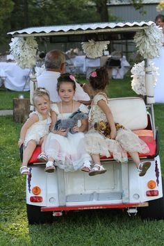 Flower girls riding on Grandpa's shuttle.  Luke and Cheyenne's wedding  pic by Kady Bennett