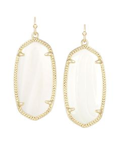 Elle Earrings in White - White mother-of-pearl is a popular, classic color here at Kendra Scott.  Our Elle Earrings encompass this stone in an oval, 14K gold plating for a gorgeous and dainty statement.