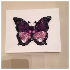 Gorgeous butterfly button art in purples on stretched canvas
