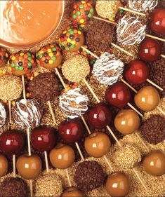 Here's a great idea so that every guest picks their favorite kind!  It's a Caramel Apple Bar where everyone picks their toppings to customize the favor exactly the way they like it!  This could be set up on the patio or in place of the cake table at Tapestry House!  Perfect for a Fall wedding!
