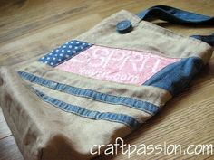Tote Bag Made From Recycled Material | Free Pattern & Tutorial at CraftPassion.com....reused plastic grocery bags plus jeans hems.
