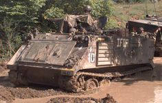Deep in the mud. An IFOR M-113 APC struggles through the muck.