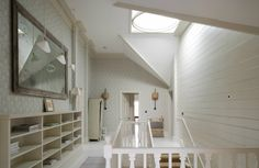 White wallpaper and wood landing with ceiling light
