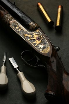 The India Rifle Detail Left Lock 'The India Rifle' which represents the largest engraving commission we have placed in recent years and was a full years work by an individual engraver.