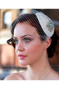 veil like this but with a silver broach/clip think instead of the white thing shown here