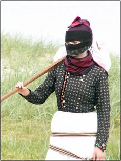 Danish traditional costume from the island Fanø. The clothes were designed to protect the womens hair and face from the wind and seasalt in the air.