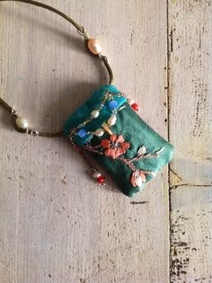 Silk pillow necklace with pearls
