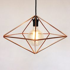 The Decahedron is made of 15 hand-cut copper tubes intricately connected with copper wires to form a Himmeli inspired pendant ceiling lamp.