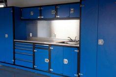 Blue garage cabinets with black border