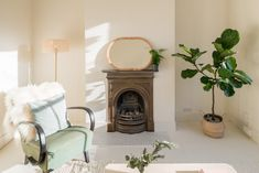 For Sale: Newport Road, London E10 | The Modern House Oak Worktops, Cast Iron Fireplace, Roll Top Bath, Rural Retreats, Elegant Living Room, Sash Windows, Private Garden, White Tiles, Two Bedroom